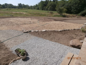 gravel walk-way, newly-seeded lawn and garden beds.