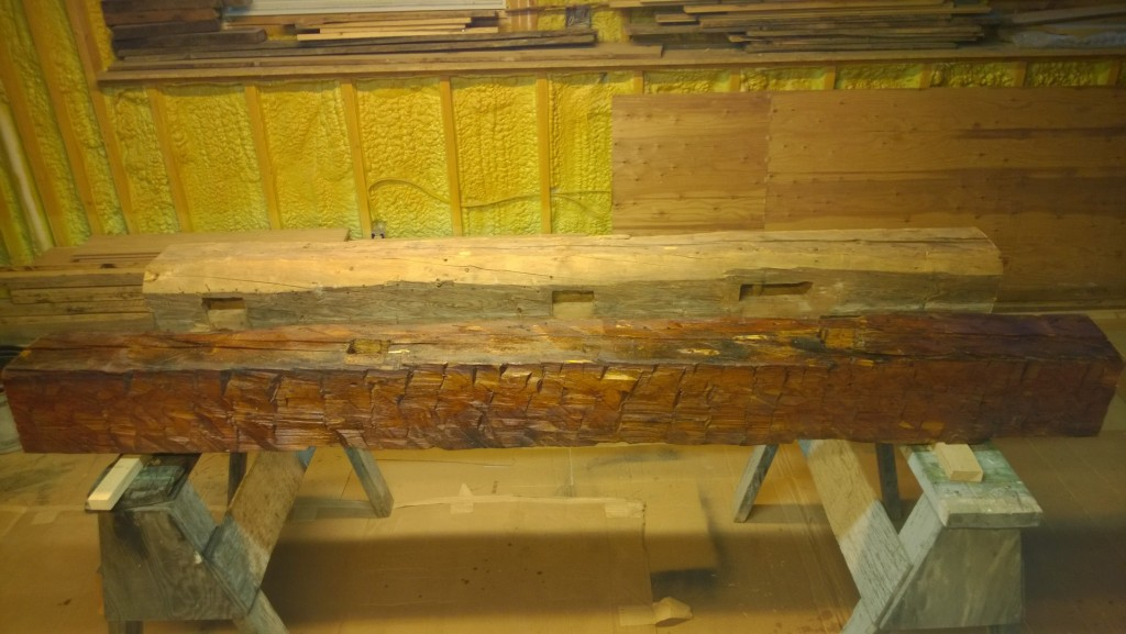 Remember the beam that dislodged when I pulled on the insulation? I cut it in half and made 2 posts to go in the living room and hold the house up.  The one in the back has been drying for 200 years.  The one in the front is drunk on Mary's sealer.